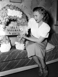 Priscilla Lane sitting on a Couch and Reading Photo by  Movie Star News