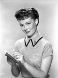 Phyllis Kirk Writing List Pose wearing Collar Shirt in Gray scale Portrait Photo by  Movie Star News
