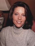 Pretender Cast Member Andrea Parker smiling in a Portrait wearing Gray Sweater Photo af Movie Star News