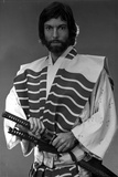 Richard Chamberlain standing in Swordsman Attire With Sword Photo by  Movie Star News