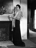 Sylvia Sidney Leaning on a Fireplace in Black Long Skirt Photo by  Movie Star News