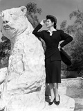 Rosalind Russell Leaning on Bear Statue Photo by  Movie Star News