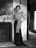 Sylvia Sidney posed Beside the Fireplace and Hand on Waist Photo by  Movie Star News