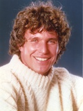 Tom Berenger smiling in White Sweater Close Up Portrait Photo by  Movie Star News