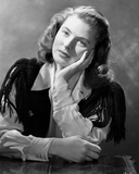 Ingrid Bergman wearing a White Long Sleeve Blouse and Face Leaning on Hand Photo by E Bachrach