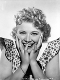 Penny Singleton smiling with Hands on Face in polka dot Dress Portrait with White Background Foto af  Movie Star News