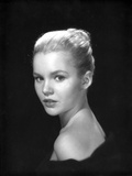 Tuesday Weld in Classic Portrait wearing Black Sleeveless Top Photo by  Movie Star News