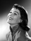 Phyllis Kirk smiling and Looking Up wearing Coat in Gray scale Portrait Photo by  Movie Star News