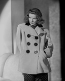 Katharine Hepburn Pose with A Coat in Black and White Photo by E Bachrach