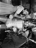 Wizard Of Oz Dorothy Helping Tin Man with Scarecrow in Movie Scene- Photograph Print Photo by  Movie Star News
