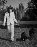 Katharine Hepburn in White Suit with A Dog Photo by A Kahle