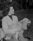 Katharine Hepburn Holding a Dog in White Dress Photo by A Kahle