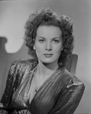 Maureen O'Hara in Black Gown Portrait wearing Shiny Blouse on a Chair Photo by E Bachrach