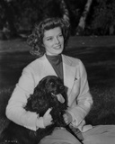 Katharine Hepburn Pose in White Dress with Black Dog Photo by A Kahle