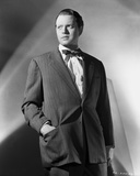 Orson Welles standing in Hand on Pocket Photo by E Bachrach