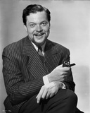 Orson Welles smiling in Black and White Photo by E Bachrach