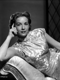 Vera Miles laying on a chaise lounger wearing oriental dress, with head propped into her hand Photo by  Movie Star News