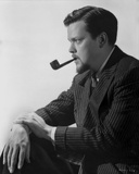 Orson Welles Pipe on Mouth in Classic Photo by E Bachrach