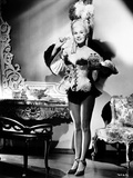 Virginia Mayo standing in Corset Photo by  Movie Star News