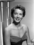 Vera Miles wearing a sleeveless, sweetheart designed bodice accentuated with drop earrings and neck Photo by  Movie Star News