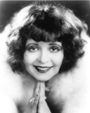 Clara Bow smiling in Fur Dress with Hand Below Chin Portrait Photo by  Movie Star News
