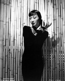 Anna Wong wearing a Black Dress and a Necklace Photo by  Movie Star News