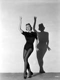 Vera Zorina wearing black leotard, black stockings, and side-clasped dance shoes, with one arm rais Photo by  Movie Star News