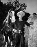 Gene Autry Leaning on a Big Rock Photo by  Movie Star News