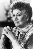 Joan Plowright wearing a Well Detailed Dress, Clasping Hands in a Classic Portrait Photo by  Movie Star News