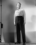 Orson Welles standing in Classic Photo by E Bachrach
