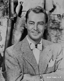 Alan Ladd smiling and wearing a Striped Suit Portrait in Classic Photo by  Movie Star News