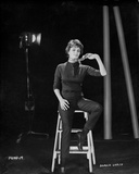 Sophia Loren sitting on a Portable Ladder in a Portrait Photo by Bud Fraker