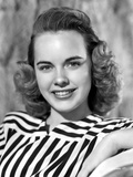 Terry Moore on a Stripe Top and smiling Photo by  Movie Star News