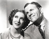 George Burns smiling with Woman Photo by  Movie Star News