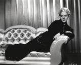 Alice Faye sitting and Lying on Sofa Photo by  Movie Star News