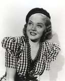 Alice Faye on Checkered and smiling Photo by  Movie Star News