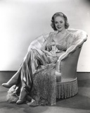 Alice Faye sitting on the Chair Legs Crossed Photo by  Movie Star News