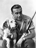 Wallace Reid posed with Dog in Classic Portrait Photo by  Movie Star News