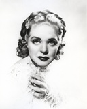 Alice Faye Looking at the Camera Holding Her Shoulder Photo by  Movie Star News