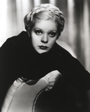 Alice Faye sitting and Leaning on the Chair wearing Black Dress Photo by  Movie Star News