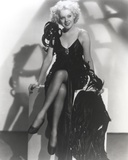Alice Faye sitting on the Table wearing a Black Dress Photo by  Movie Star News