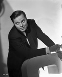 Orson Welles Seated smiling in Classic Photo by Ted Alan