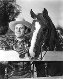 Gene Autry Leaning on Fence with a Horse Photo by  Movie Star News