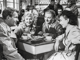 Until They Sail Man and Three Woman Having Conversation Photo by  Movie Star News