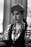 Molly Ringwald Portrait wearing Black vest with Plaid Sleeves Photo by  Movie Star News