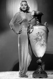 Marlene Dietrich standing in Classic Gown with Jar Photo by AL Schafer