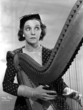 Zasu Pitts Looking Away while Playing a Harp in polka dot Dress Photo by  Movie Star News