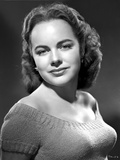 Terry Moore on a Knitted Off Shoulder Portrait Photo by  Movie Star News