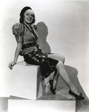 Alice Faye on Checkered Top sitting and smiling Portrait Photo by  Movie Star News