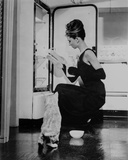 Audrey Hepburn holding Ballet Shoes and Feeding the Cat Photo autor Movie Star News